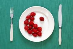 Yin y símbolo de yang hecho de fresas Foto de archivo