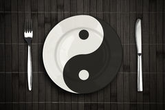 Yin yan plate over bamboo placemat concept Stock Photo