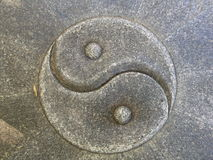 Yin and Yang. The Yin and Yang symbol carved from stone Stock Photo