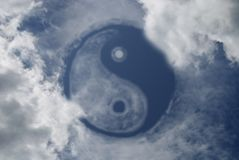 Yin and Yang. Sign in sky Royalty Free Stock Photos