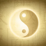 Yin Yang. Symbol with writing on Chinese Taijitu (English translating diagram of ultimate power- term which mean yin and yang) at grunge background Royalty Free Stock Photos