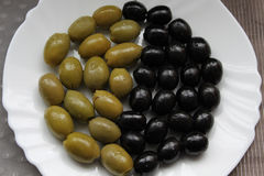 Yin and yang. Made from black and green olives Royalty Free Stock Images