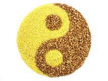 Yin and yang. Drawn by means of millet and buckwheat grains Royalty Free Stock Image