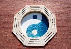 Yin Yang and bagua. Tai Chi pattern carved in the wall Vector Illustration