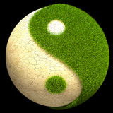 Yin Yang ball. Made out of grass and cracked ground Royalty Free Stock Photos