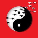 Yin Yang Birds. Black and white birds and a yin yang symbol are featured in a paper cutout style illustration Stock Photography
