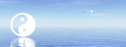 Yin and yang on blue ocean. White yin and yang symbol and a seagull in a blue background with ocean Stock Photo