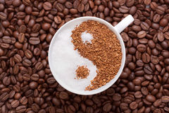 Yin Yang coffee. Sweet sugar and bitter coffee in the form of the Yin Yang Royalty Free Stock Images