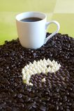 Yin Yang Coffee. Coffee cup with white chocolate chips and milk chocolate chips forming a yin yang symbol Stock Photos