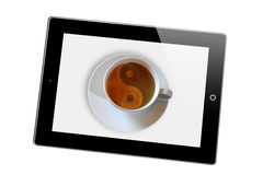 Yin and Yang coffee. A tablet computer or picture frame with a cup of coffee with the Yin and Yang symbol Royalty Free Stock Photo