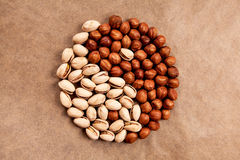 Yin Yang made of pistachios and hazelnuts stock images