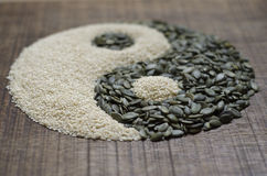 A yin yang made from seeds Royalty Free Stock Photo