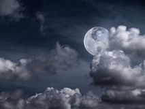 Yin Yang Moon. Moon with a sign of Yin Yang in the clouds Stock Photography
