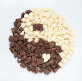 Yin-yang of pieces of black and white chocolate. Yin-yang of pieces of black and white chocolate Royalty Free Stock Photo