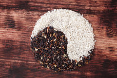 Yin Yang rice. White and wild rice forming Yin Yang Symbol. Healthy balanced cooking. Traditional chinese culture Stock Images