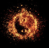 Yin and yang spark. Is isolated on black background Royalty Free Stock Photo