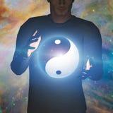 Yin Yang Star man. Man holds Yin Yang Sphere Stock Photography