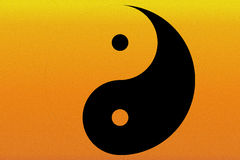 Yin and Yang on a Sunset Background Royalty Free Stock Image