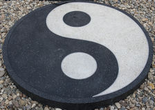 Yin Yang symbol. Placed on the gravel Royalty Free Stock Images