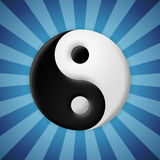 Yin yang symbol on blue rays background Royalty Free Stock Photo