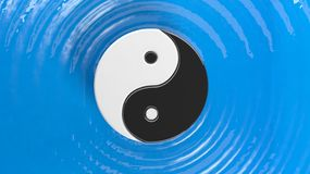 Yin and Yang symbol on blue water Stock Image