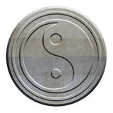 Yin Yang symbol carved in stone Royalty Free Stock Photo