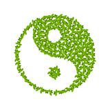 Yin Yang symbol with green leaves Stock Images