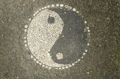 Yin-Yang Symbol made of little stone pebbles royalty free stock photography