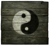 Yin yang symbol. On old wooden planks Stock Photography