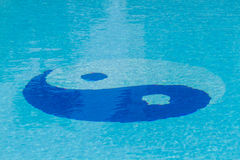 Yin Yang symbol in the pool. Royalty Free Stock Photo