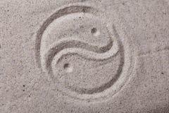 Yin yang symbol in sand Royalty Free Stock Image