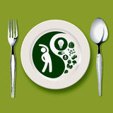 Yin yang symbol on white plate Royalty Free Stock Image