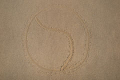 Yin yang symbol - written in sand on beach texture - soft wave of the sea Royalty Free Stock Photo