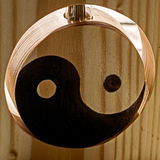 Yin and Yang on a wooden stand Royalty Free Stock Images