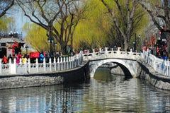 Yinding Bridge, Beijing in eraly spring. Yinding Bridge (Silver Ingot Bridge), a landmark in Beijing's tourist destination Houhai Lake.First built in Ming royalty free stock photo