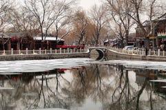 Yinding Bridge, Beijing after snow. Yinding Bridge (Silver Ingot Bridge), a landmark in Beijing's tourist destination Houhai Lake.First built in Ming Dynasty royalty free stock images