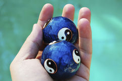 Ying yang balls. In hand Royalty Free Stock Image