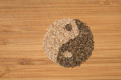 Ying yang chia seeds. Chia seeds arranged in ying yang symbol close up Stock Photo