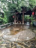 Ying and yang. Ying yang outside of teahouse drizzling Royalty Free Stock Photography