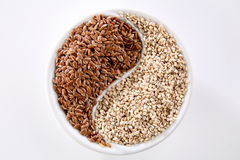 Ying Yang seeds. A ying yang of healtly seeds, linen and sesame Royalty Free Stock Photo
