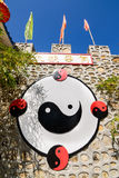 Ying yang symbol on chinese stone wall. Royalty Free Stock Images