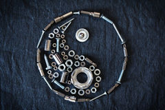 Ying yang symbol. Composed of the tools and screw on a dark background Stock Image