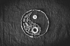 Ying yang symbol. Composed of the tools and screw on a dark background Stock Photos