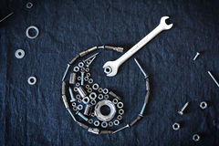 Ying yang symbol. Composed of the tools and screw on a dark background Stock Images