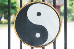 Ying and Yang symbol hang on the gate of a Taoist temple in Chin. Ying and Yang symbol hang on the gate of a Taoist temple in Chengdu, China Stock Photo