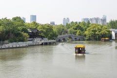 Yingyue bridge and gaily-painted pleasure-boat Royalty Free Stock Photo