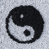 YinYang symbol made of gravel. Stones top view Royalty Free Stock Photo