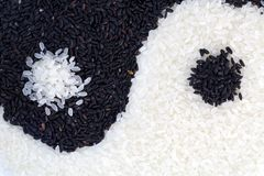 Yinyang. Made from black and white rice. Closeup. Top view Stock Image