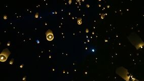 Yipeng Lanna festival during Loy krathong in Thailand laterns floating in full moon sky