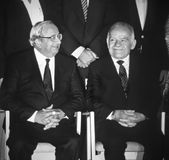 Yitzhak Navon and Yitzhak Shamir. Yitzhak Navon shares a laugh with incoming prime minister Yitzhak Shamir (right) at a ceremony in Beit Hanassi, the president's Royalty Free Stock Images
